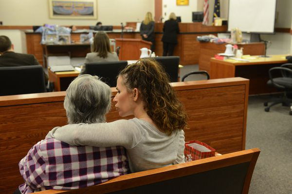Karen Steward gets a hug from Heather Robb during closing arguments in the trial of Jordan King in the courthouse in Palmer, Alaska on Thursday, Nov. 16, 2017. King is charged with attempted murder of Steward's daughter and Robb's sister among other charges. (Bob Hallinen / Alaska Dispatch News)