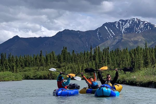 (Left to right) Alli Harvey, Emily Sullivan, and Jack Marston packraft on Cantwell Creek near Denali National Park on June 27, 2021. (Photo by Trish Franco)