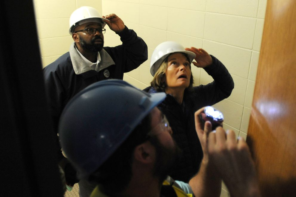 Sens. Lisa Murkowski looks at damage in the ceiling at Houston Middle School on Monday, Dec. 3. 2018. (Bill Roth / ADN)