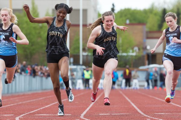 South's Paige Searles, left, edges out her teammate Sarah Robinson by 0.01 second to win the 100 meter race Saturday, May 18, 2019 during the CIC track and field championships at Dimond High. Searles won with a time of 12.47 seconds. (Loren Holmes / ADN)