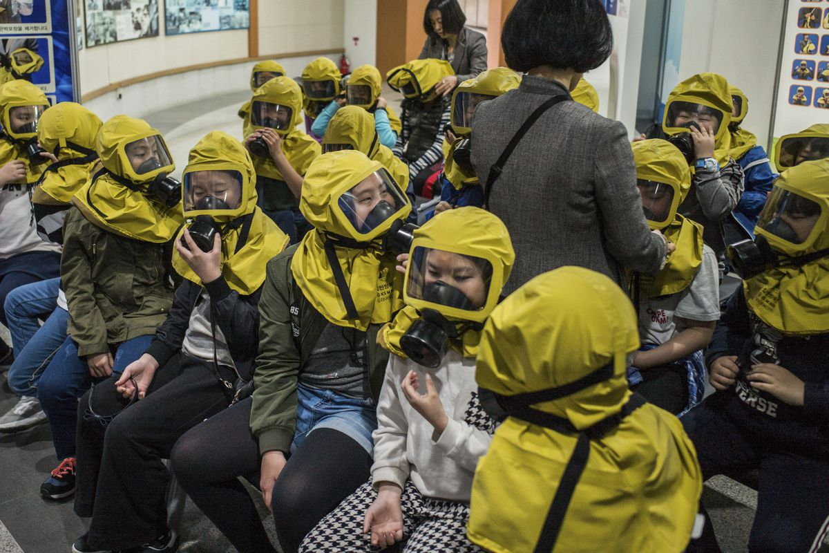 Students learn to use gas masks in case of an event of chemical or biological attacks, at a training center next to the War Memorial of Korea in Seoul, South Korea, April 21, 2017. (Lam Yik Fei/The New York Times file)