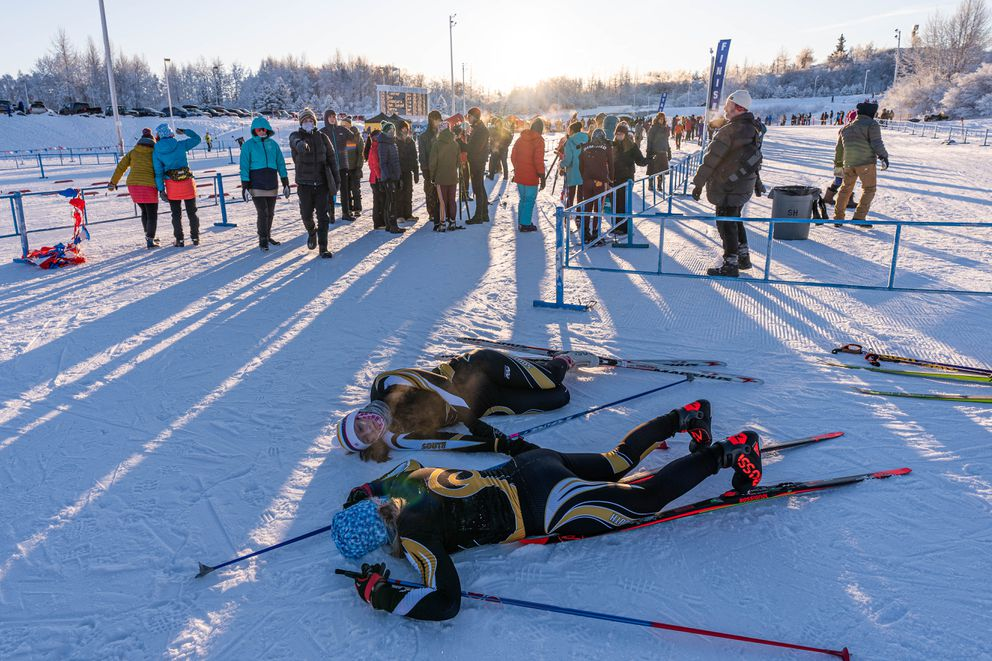 South skiers Ali Ulrich and Maura Black recover after their race. (Loren Holmes / ADN)