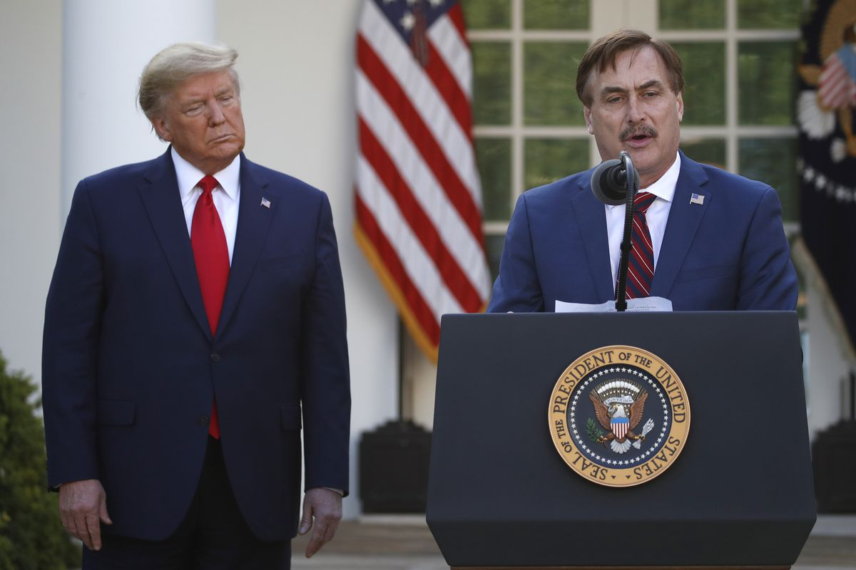 In this March 30 photo, My Pillow CEO Mike Lindell speaks as President Donald Trump listens during a briefing about the coronavirus in the Rose Garden of the White House. (AP Photo/Alex Brandon, File)