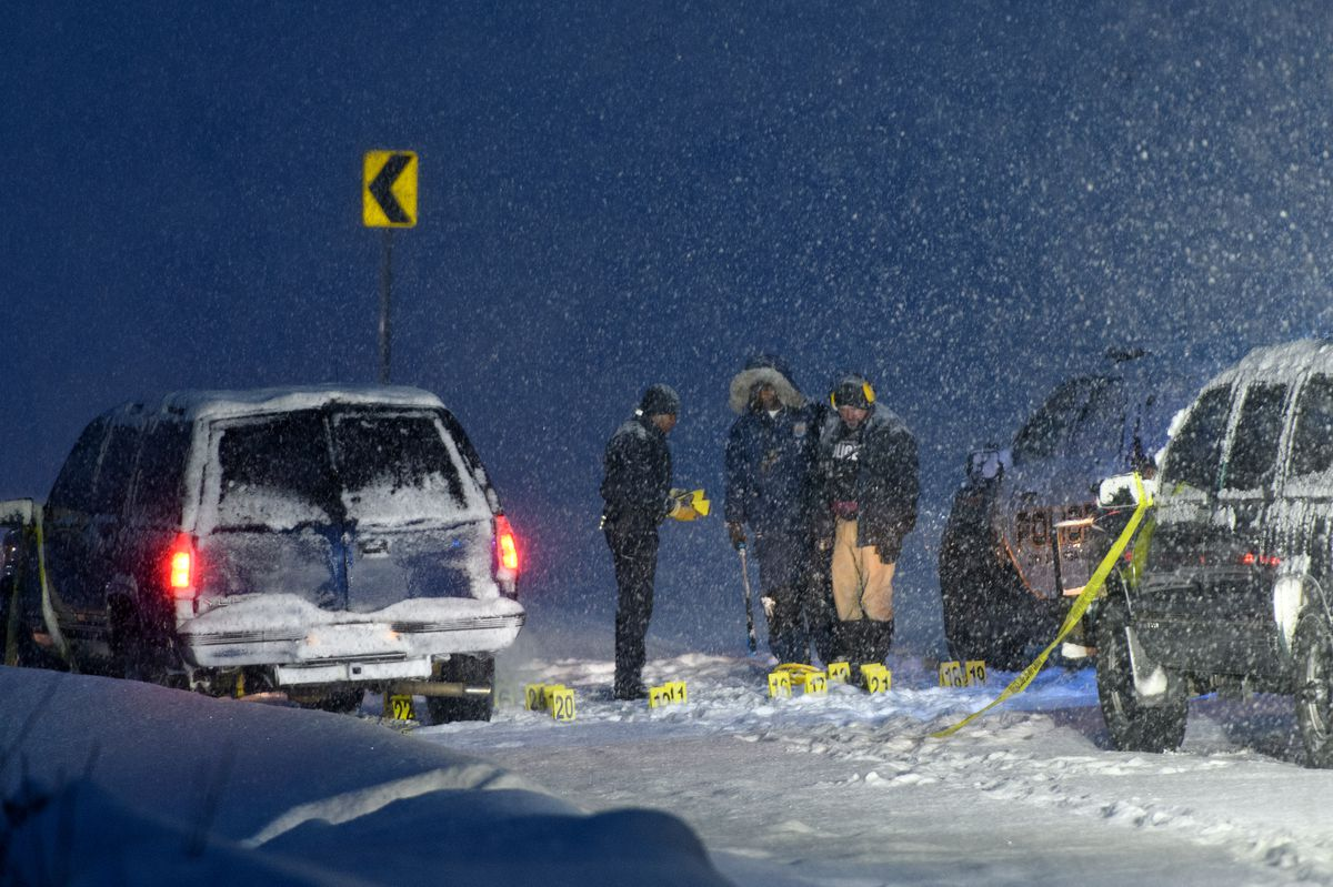 Police investigate an officer-involved shooting on the Elliott Highway, about three miles north of Fox, on February 12, 2019. Fairbanks Police say Garrett James Ebenal was shot and killed by police after pointing a gun at them after a pursuit. (Marc Lester / ADN)