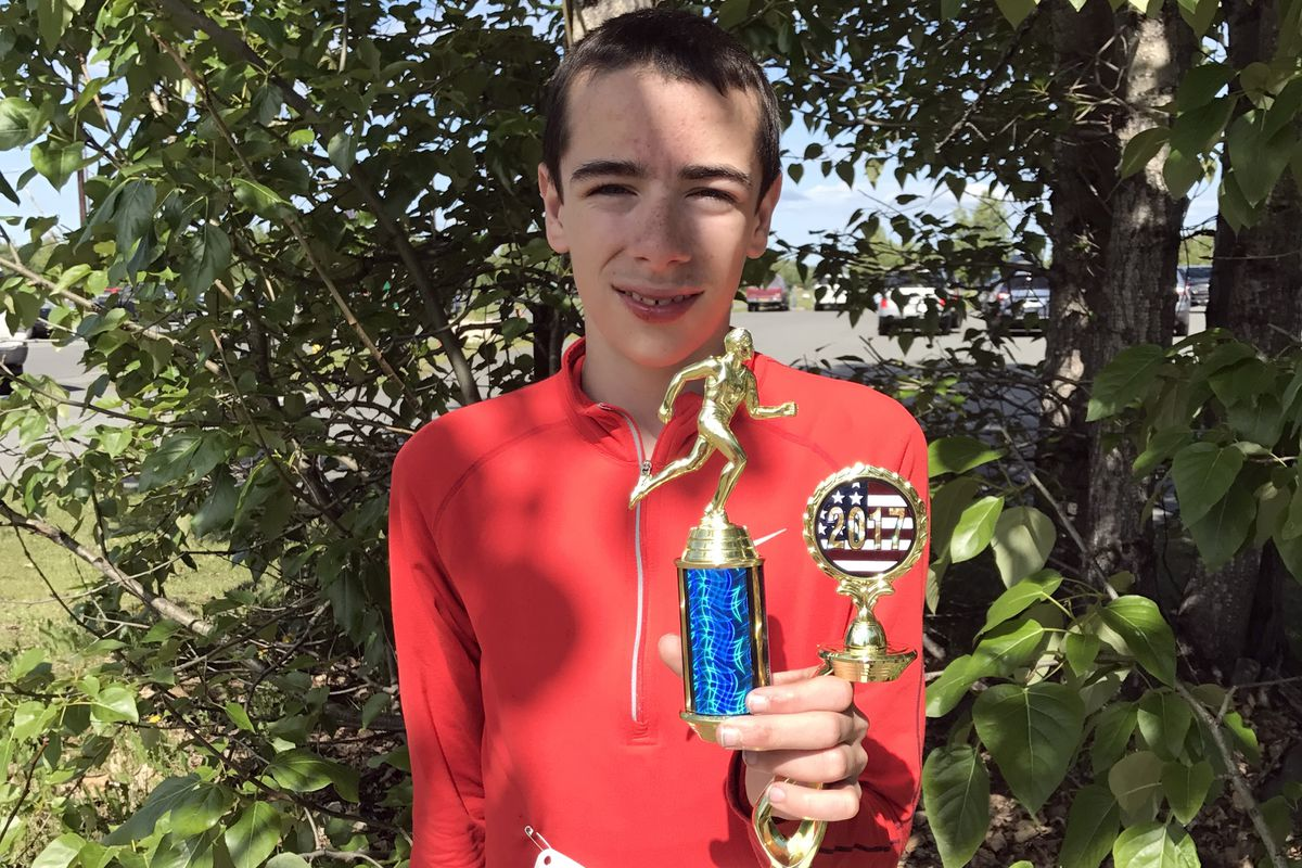 Jack Cooper holds the trophy he won in the Arctic Valley 5-mile race. (Courtesy Katrina and Rose Garner)