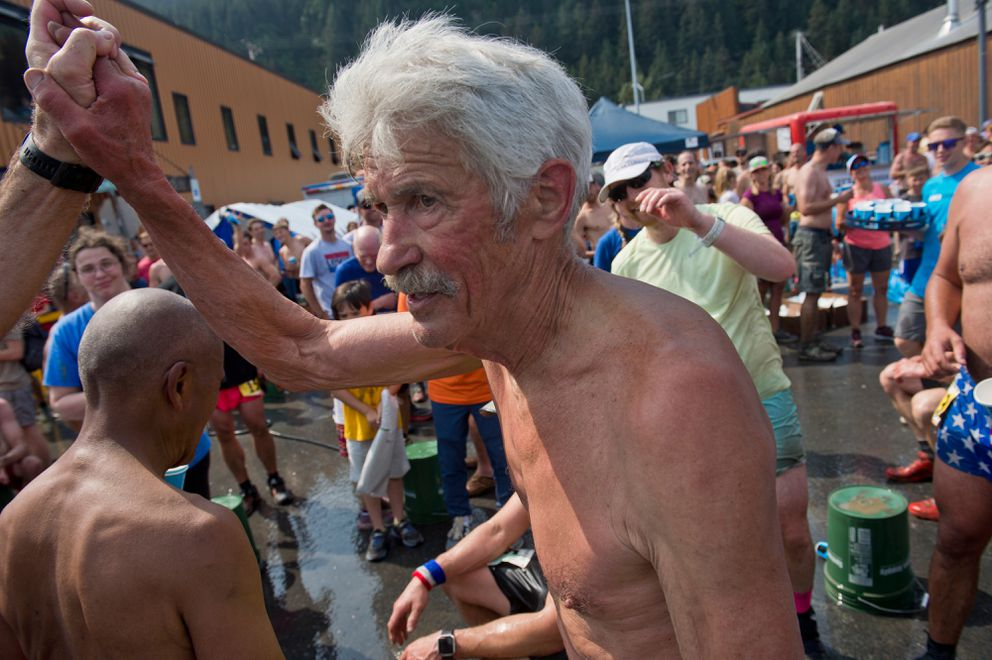 Fred Moore is congratulated after he finished his 50th consecutive Mount Marathon men's race last year. (Marc Lester / ADN)