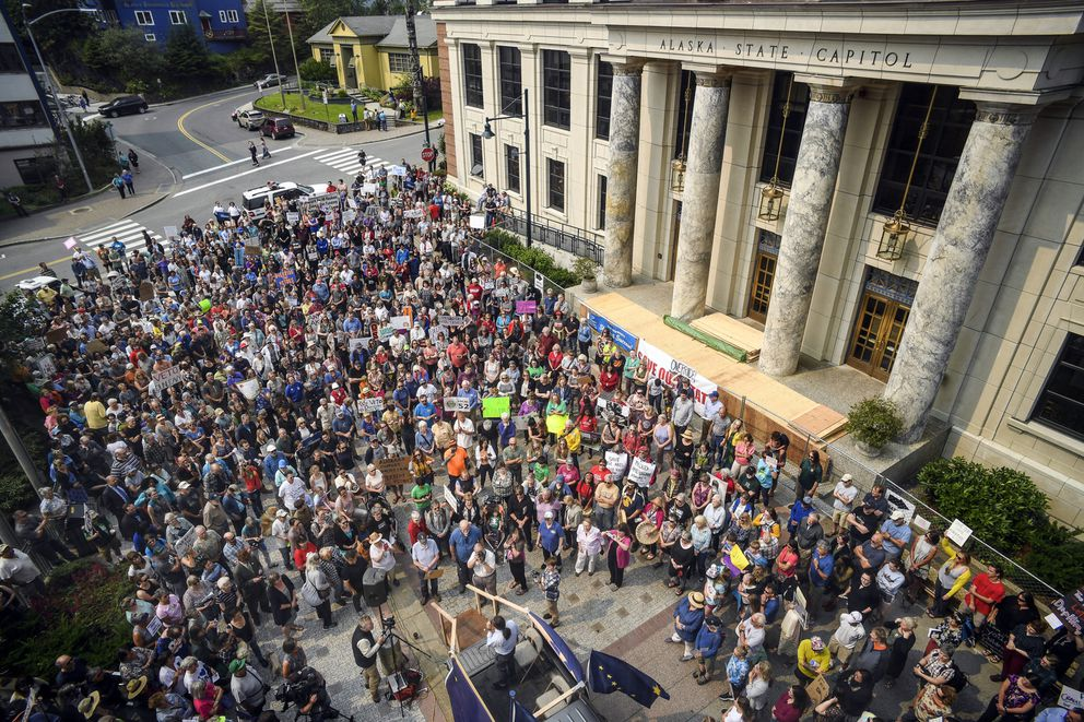Hundreds attend a rally in front of the Capitol, calling for an override of Gov. Mike Dunleavy's budget vetos on the first day of the Second Special Session of the Alaska Legislature in Juneau on Monday, July 8, 2019. (Michael Penn/Juneau Empire via AP)