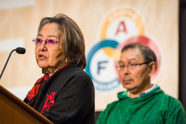 Rosita Worl, left, and Myron Naneng deliver the subsistence committee report to the Alaska Federation of Natives on Friday, October 24, 2014 at the Dena'ina Civic and Convention Center.