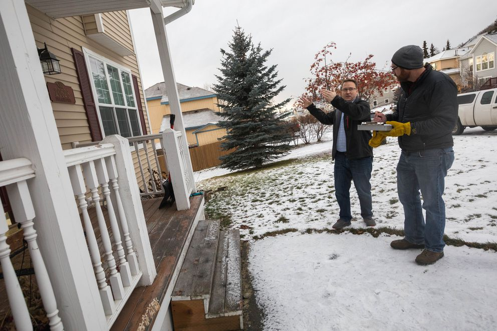 Eagle River homeowner Duncan Whitney explains damage he observed after Friday's 7.0 earthquake to structural engineer Jake Horazdovsky during an inspection of Whitney's home Tuesday. (Loren Holmes / ADN)