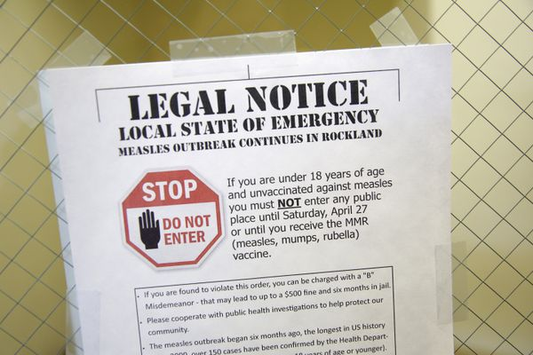 FILE - In this March 27, 2019, file photo, a sign explaining the local state of emergency is displayed at the Rockland County Health Department in Pomona, N.Y. Measles cases in the U.S. this year have climbed to the highest level in 25 years, according to preliminary figures, a resurgence attributed largely to misinformation about vaccines. (AP Photo/Seth Wenig, File)
