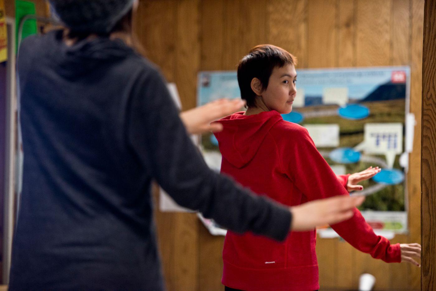 A dancer looks over her shoulder at others. (Marc Lester / Alaska Dispatch News)