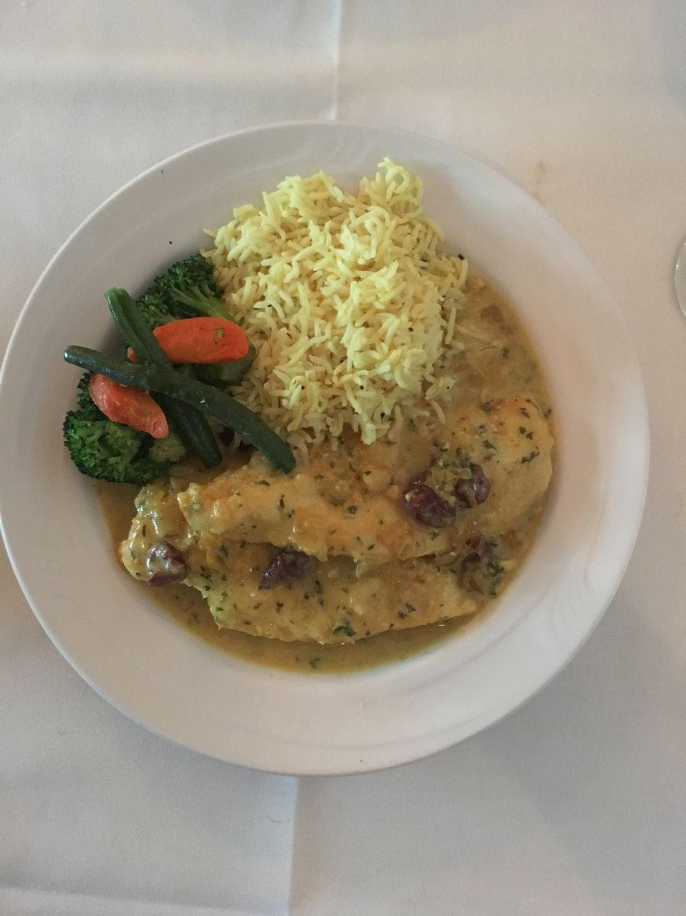 Poulet de Casablanca is sautéed chicken breast with a saffron, kalamata olives and lemon sauce. (Photo by Mara Severin)