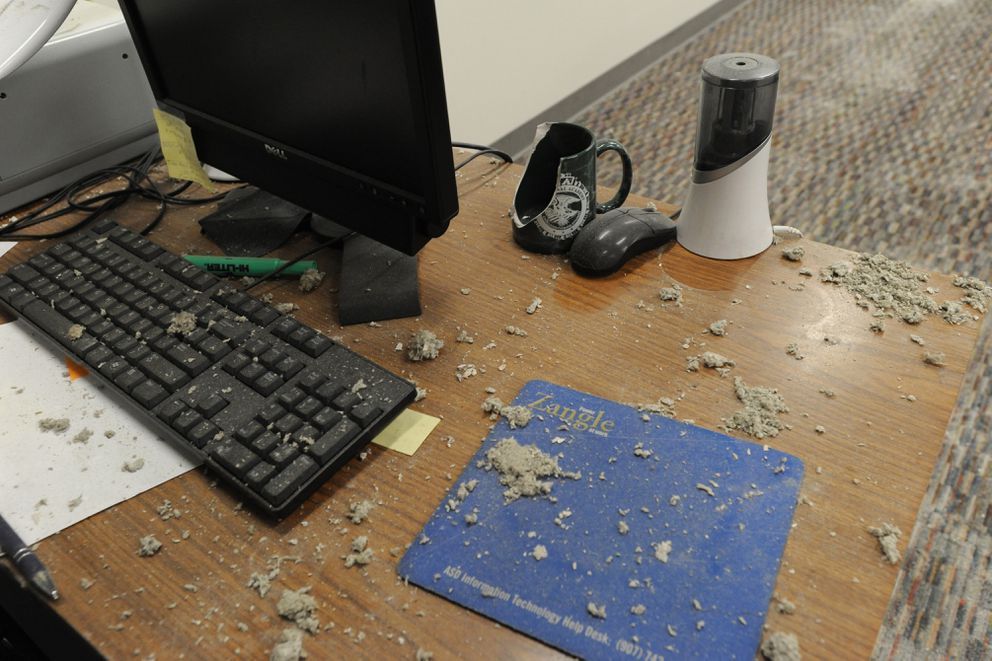 A teacher's desk at Bartlett High School is covered in debris after Friday's 7.0 earthquake. (Bill Roth / ADN)