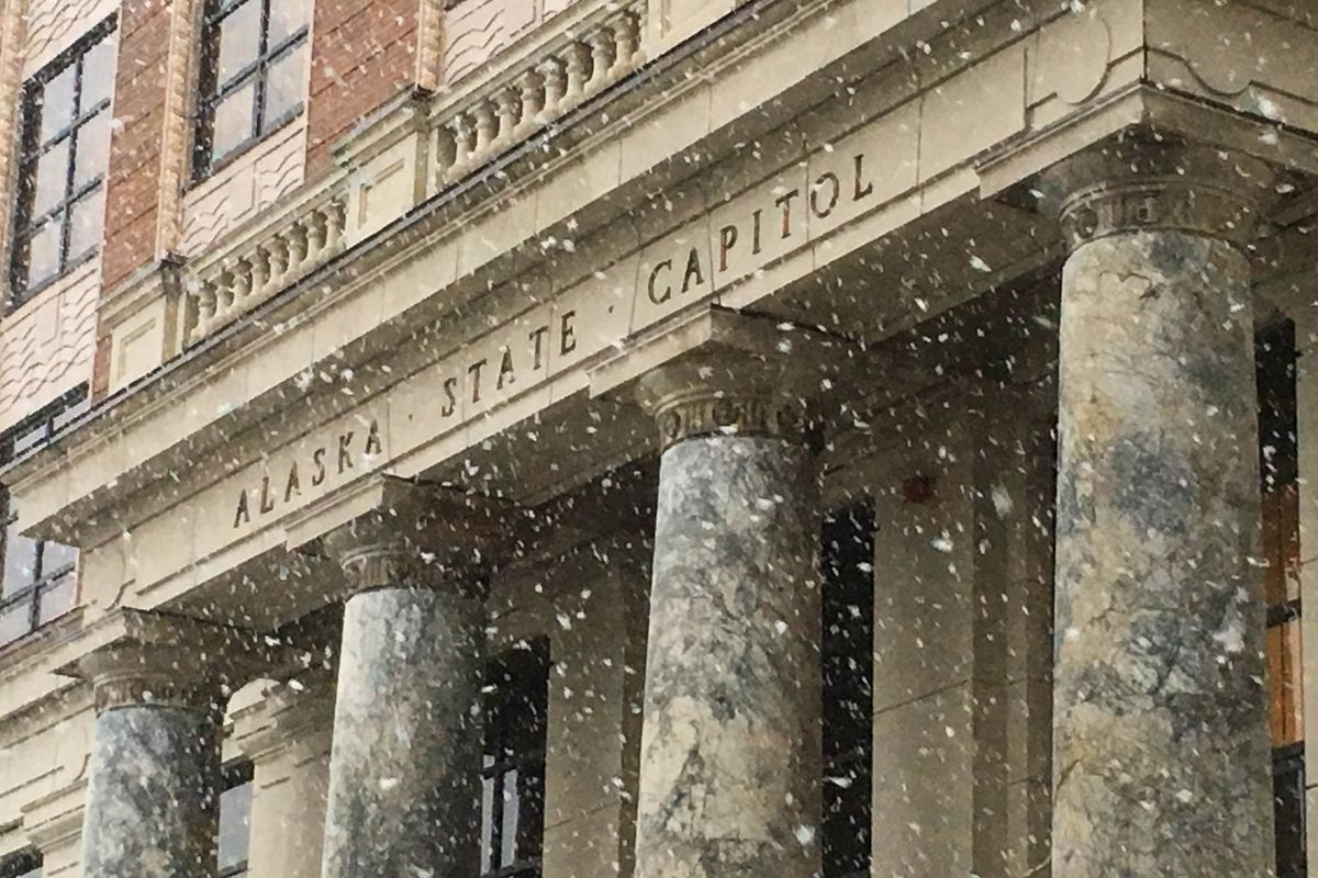 Snow falls at the Alaska State Capitol on Tuesday, Jan. 29, 2019. (James Brooks / ADN)
