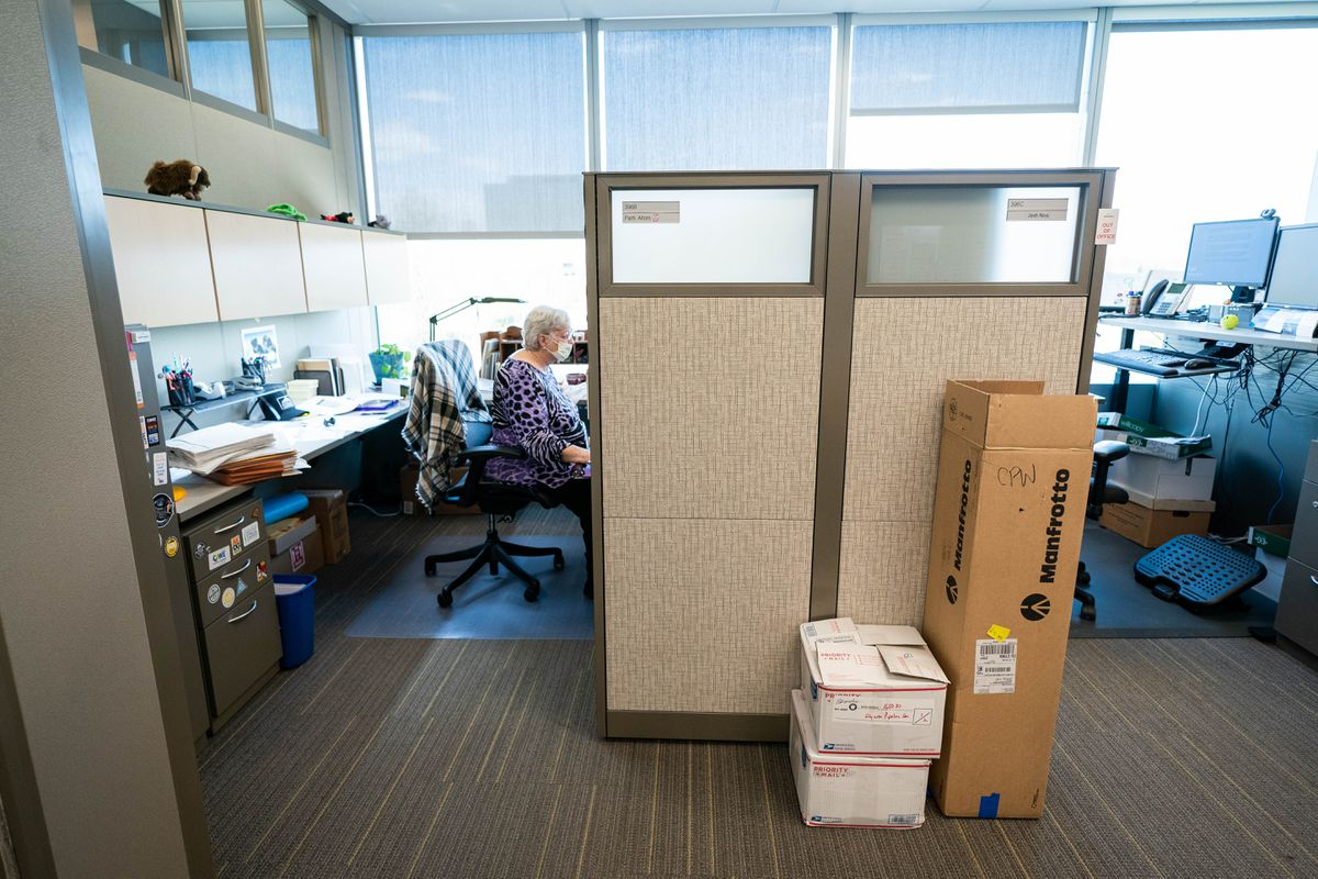 Patti Altom works in a mostly empty office at Alyeska Pipeline Service Company on Thursday, May 14, 2020 in Anchorage. The company is allowing, but not requiring, up to 33% of their office workers to return to work in the building. (Loren Holmes / ADN)