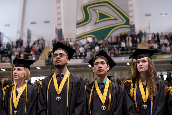 From left: Honors College grads Annika Flynn, B.A. Psychology, Amer Chaudhry, B.S. Natural Sciences, Jonathan Yuquimpo, B.S. Psychology, and Erin Brayfield, B.A. Journalism and Public Communications, wait to receive their degrees during UAA's 2019 Spring Commencement at the Alaska Airlines Center. (Photo by James Evans / UAA)