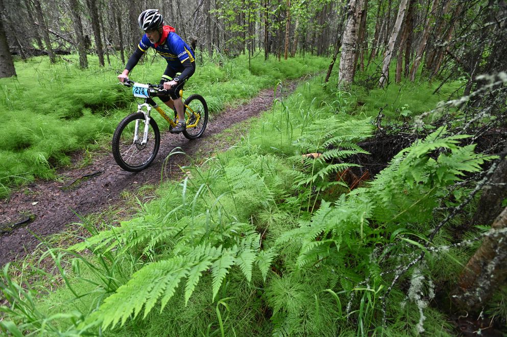 Tol Fishburn rides through the woods at Mirror Lake. (Bill Roth / ADN)