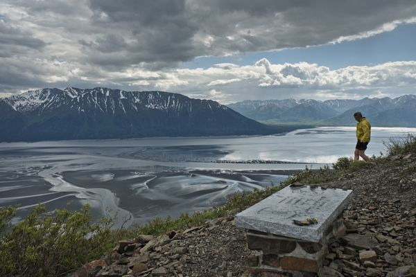 """A memorial bench for Patrick """"Jack"""" Cooper overlooks Bird Creek and Turnagain Arm from midway up the Bird Ridge trail on June 14, 2018. (Marc Lester / ADN)"""