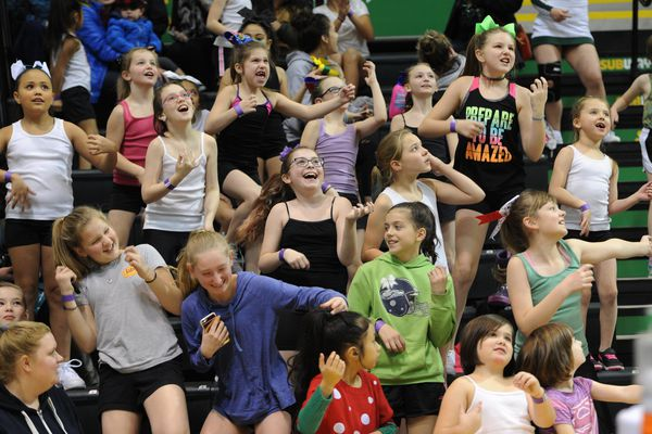 Pop Warner cheerleaders from Anchorage and the Mat-Su look up at the Air Guitar Cam during the Seawolves' 69-59 victory over the Maryland Eastern Shore Hawks on the opening day of the GCI Great Alaska Shootout in the Alaska Airlines Center at UAA on Tuesday, Nov. 21, 2017. (Bill Roth / ADN)