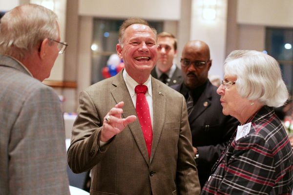 FILE PHOTO: Republican candidate Roy Moore greets supporters at the RSA Activity center in Montgomery, Alabama, U.S. September 26, 2017, during the runoff election for the Republican nomination for Alabama's U.S. Senate seat vacated by Attorney General Jeff Sessions. REUTERS/Marvin Gentry/File Photo