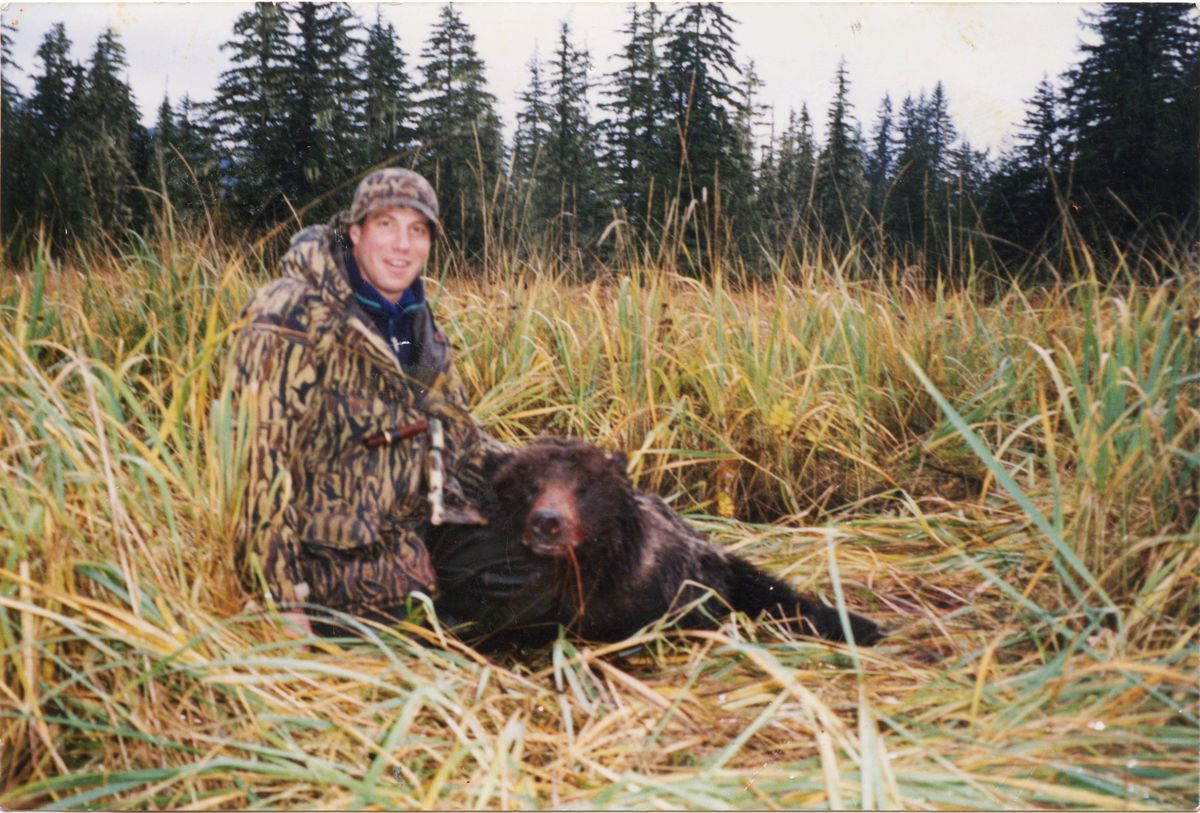 US Senate candidate Al Gross with a bear he killed in self-defense on Oct. 19, 1995 in Sweetheart Flats, south of Juneau. (Photo provided by Al Gross campaign)