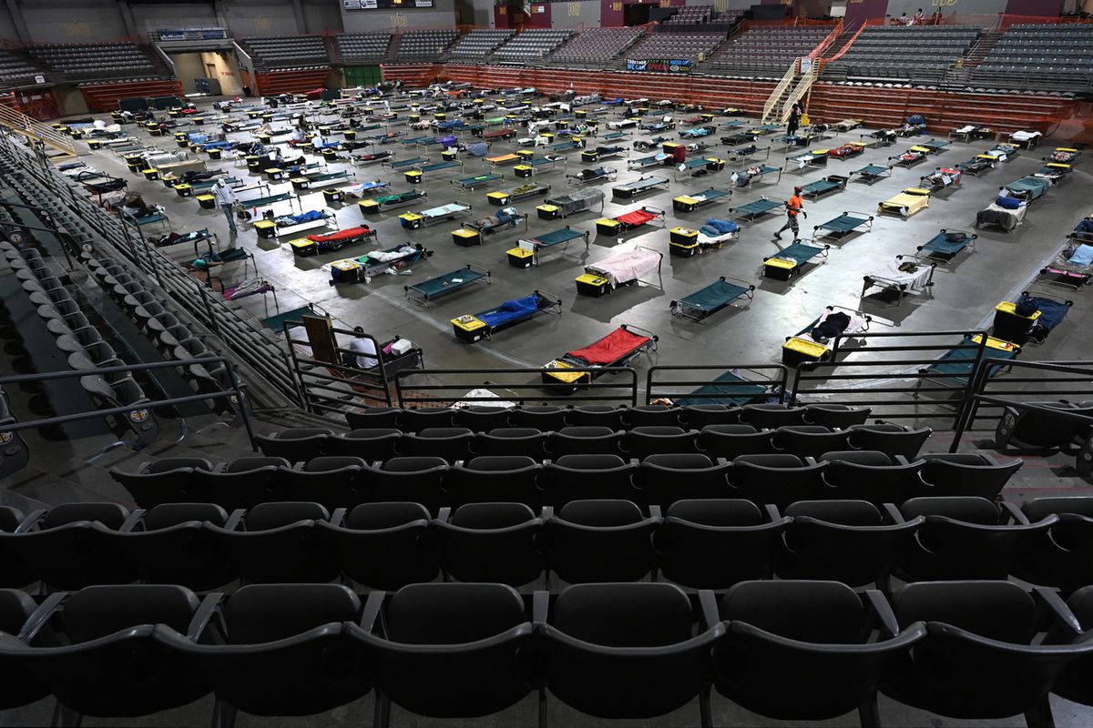 Cots fill the floor of the Sullivan Arena on Monday, July 19, 2021. The mass shelter for homeless clients is operated by Bean's Cafe. (Bill Roth / ADN)
