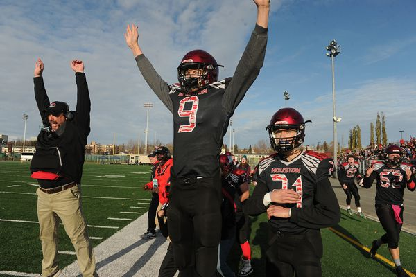 Kyle McLaughlin and Jordan Kolb, of Houston, celebrate their last touch down against Barrow at Anchorage Football Stadium in Anchorage, AK on Saturday, October 19, 2019. Houston defeated Barrow 41-8 to win the Division III Alaska State Championship game. (Bob Hallinen photo)