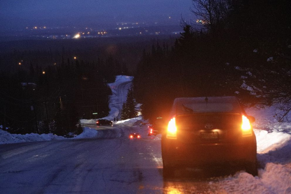 Cars stop in the snow along Hillside Drive on Thursday morning on the Anchorage Hillside. (Loren Holmes / Alaska Dispatch News)