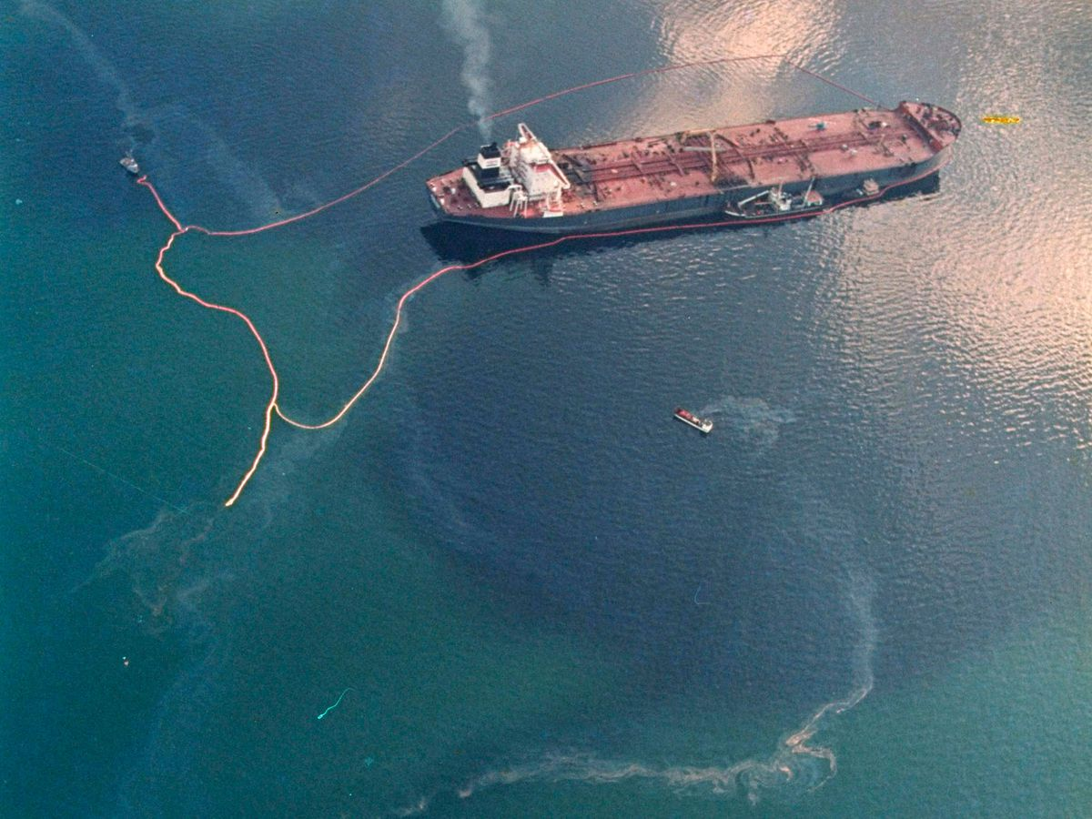 FILE - In this April 9, 1989, file photo, crude oil from the tanker Exxon Valdez, top, swirls on the surface of Alaska's Prince William Sound near Naked Island, Alaska. Thirty years after the Exxon Valdez hit a reef and spilled about 11 million gallons of oil in Prince William Sound, the state of Alaska is looking whether to change its requirements for oil spill prevention and response plans, a move that one conservationist says could lead to a watering down of environmental regulations. (AP Photo/John Gaps III, File)