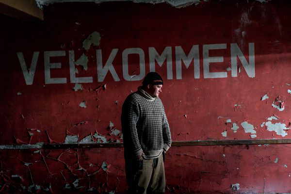 "Aksel Robertsen, a fisherman, visits a now-abandoned fish processing plant where he used to work in Vardo, Norway, May 13, 2017. Not everyone in Vardo is happy with the mysterious American-Norwegian facility which has provided a much-needed lifeline in this town that has seen half its residents leave in the last 20 years. ""We want to live off fishing, not secret radars,"" Robertsen said. (Andrew Testa/The New York Times)"