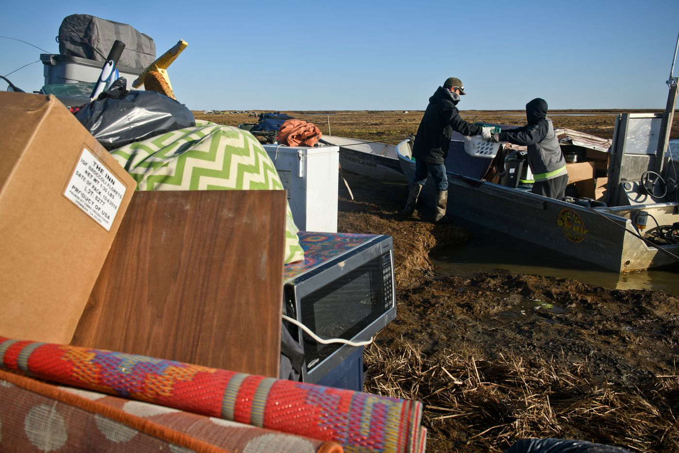 Items are stacked on the muddy flats near the Ninglick and Newtok Rivers as boats are loaded for the move to Mertarvik. (Marc Lester / ADN)