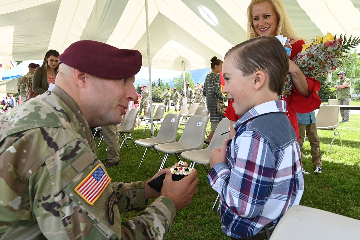 Lt. Col. John Campbell talks to his son Wyatt, 5, after assuming command of the 1st Squadron (Airborne), 40th Cavalry Regiment. Wyatt was presented a squadron coin and Campbell's wife, Abby, received a bouquet of yellow roses during the change of command ceremony. (Bill Roth / ADN)