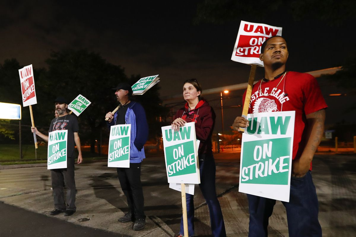 United Auto Workers members picket outside the General Motors Detroit-Hamtramck assembly plant in Hamtramck, Mich., Monday, Sept. 16, 2019. Roughly 49,000 workers at General Motors plants in the U.S. went on strike just before midnight Sunday, but talks between the UAW and the automaker will resume. (AP Photo/Paul Sancya)