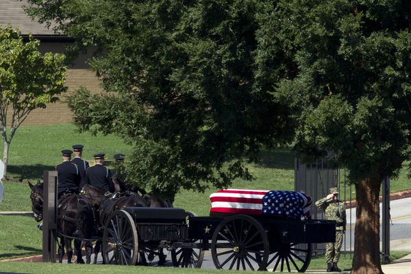 A horse drawn caisson carries the casket containing the remains of Sen. John McCain, R-Ariz., to his burial sight at the United States Naval Academy Cemetery in Annapolis Md., Sunday, Sep. 2, 2018. McCain died Aug. 25 from brain cancer at age 81. (AP Photo/Jose Luis Magana)