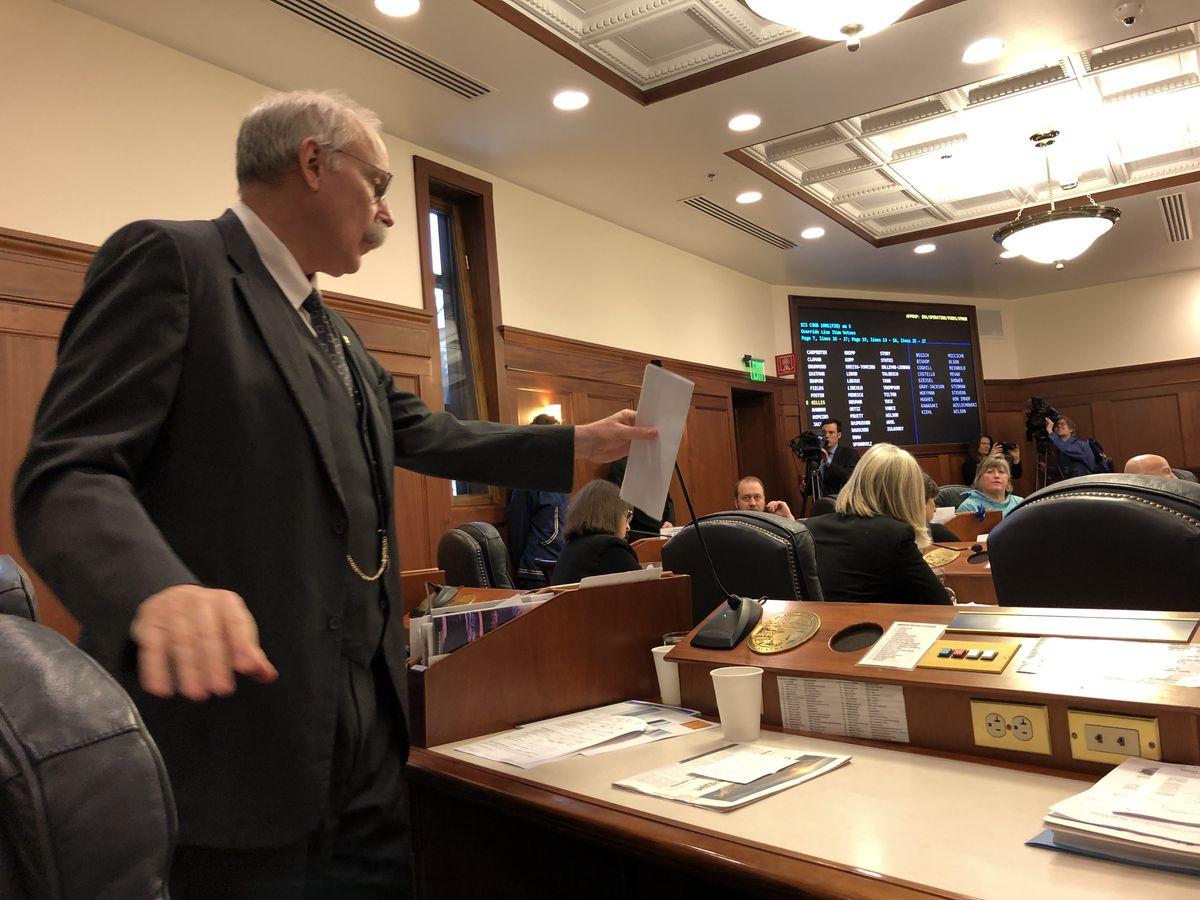 Sen. Bert Stedman, R-Sitka, prepared to speak in favor of veto overrides during a joint session of the Alaska Legislature on Friday. (James Brooks / ADN)