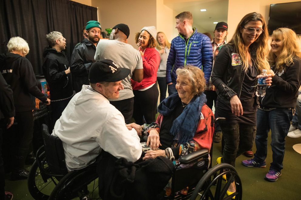 Portugal. The Man guitarist Eric Howk talks with his grandmother, 84-year-old Donna Grant, after his show Friday, Oct. 26, 2018 at the Alaska Airlines Center. (Loren Holmes / ADN)