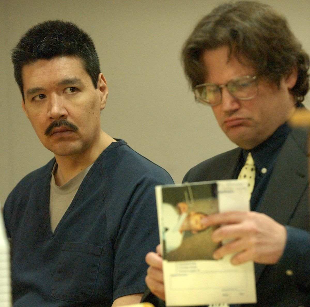 Jason Pritchard listens to prosecutor Adrienne Bachman as his attorney Doug Moody looks at photos of victim wounds during sentencing proceedings Monday, April 29, 2002. (Jim Lavrakas / ADN)