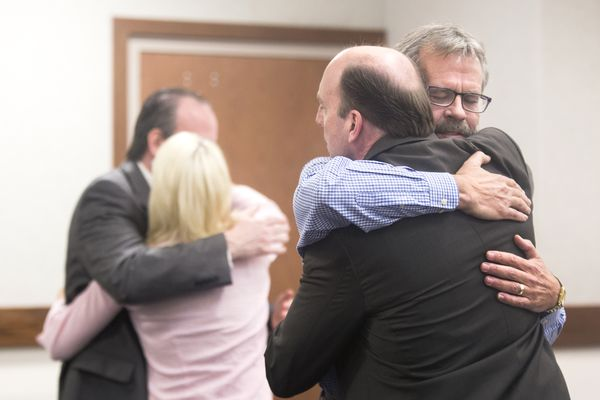 Defendant Greg Imig hugs defense attorney Kevin Fitzgerald after he and Amy DeWitt were found not guilty of starting the destructive 2015 Sockeye fire on Friday, May 12, 2017, in Palmer. (Rugile Kaladyte / Alaska Dispatch News)