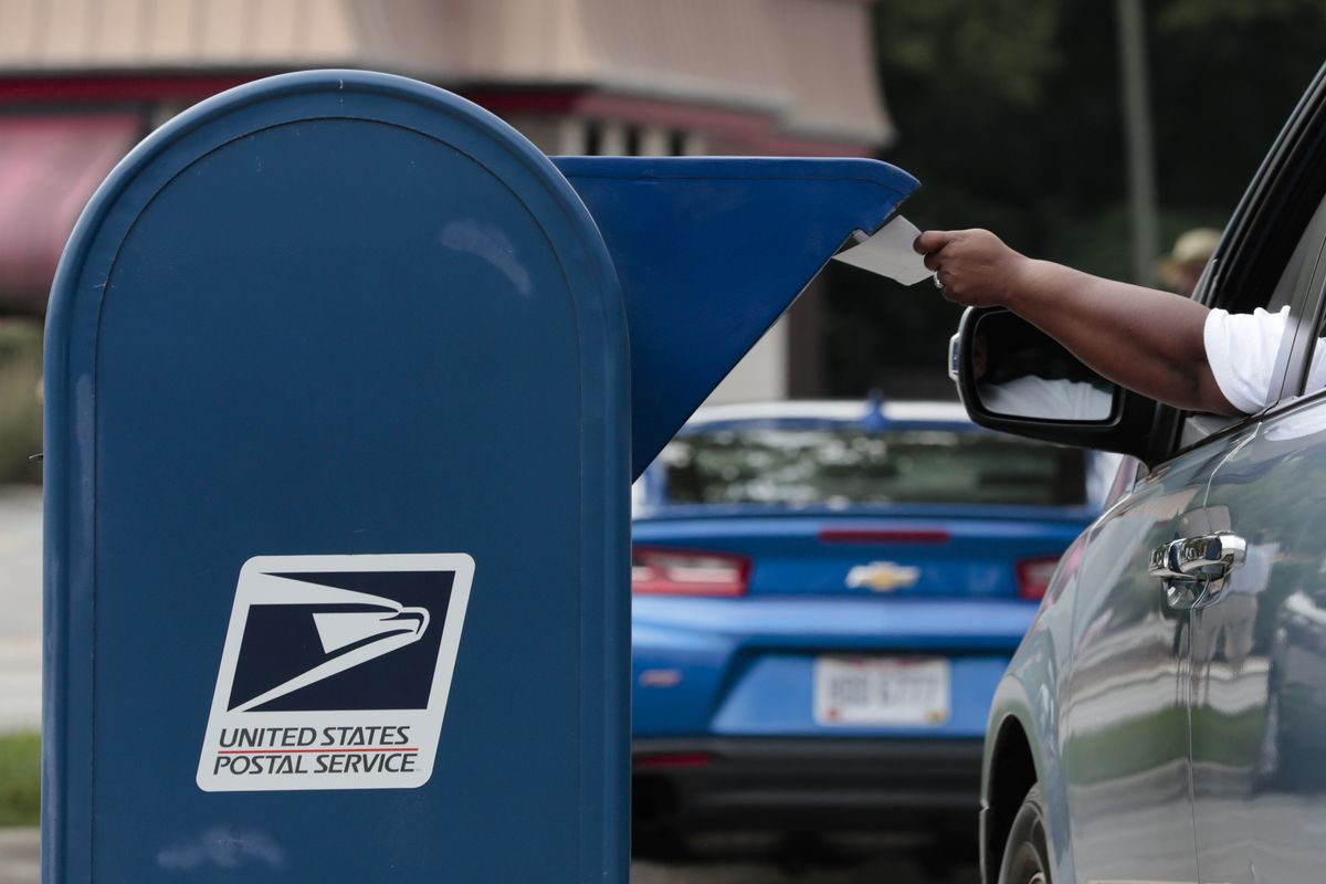 A man mails a letter on Saturday, August 22, 2020 in Whitehall, Ohio. (Joshua A. Bickel/The Columbus Dispatch via AP)