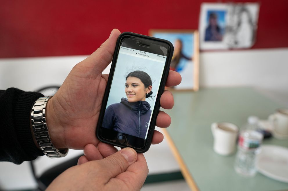 Pete Foudeas holds his phone displaying a picture of his daughter, Penelope Foudeas, at the family's restaurant, Milano's, on Saturday, April 10, 2021 in Anchorage. Foudeas, who was 22, died from injuries sustained while she was skiing at Alyeska Resort last month. (Loren Holmes / ADN)