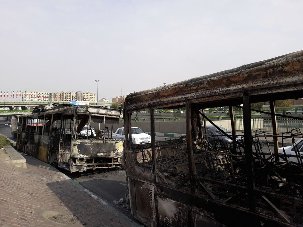 This photo released by the Iranian Students' News Agency, ISNA, shows scorched public buses that remained on the street after protests that followed authorities' decision to raise gasoline prices, in Tehran, Iran, Sunday, Nov. 17, 2019. Ayatollah Ali Khamenei, Iran's supreme leader, on Sunday backed the government's decision to raise gasoline prices and called angry protesters who have been setting fire to public property over the hike 'thugs, ' signaling a potential crackdown on the demonstrations. (Morteza Zangane/ISNA via AP)