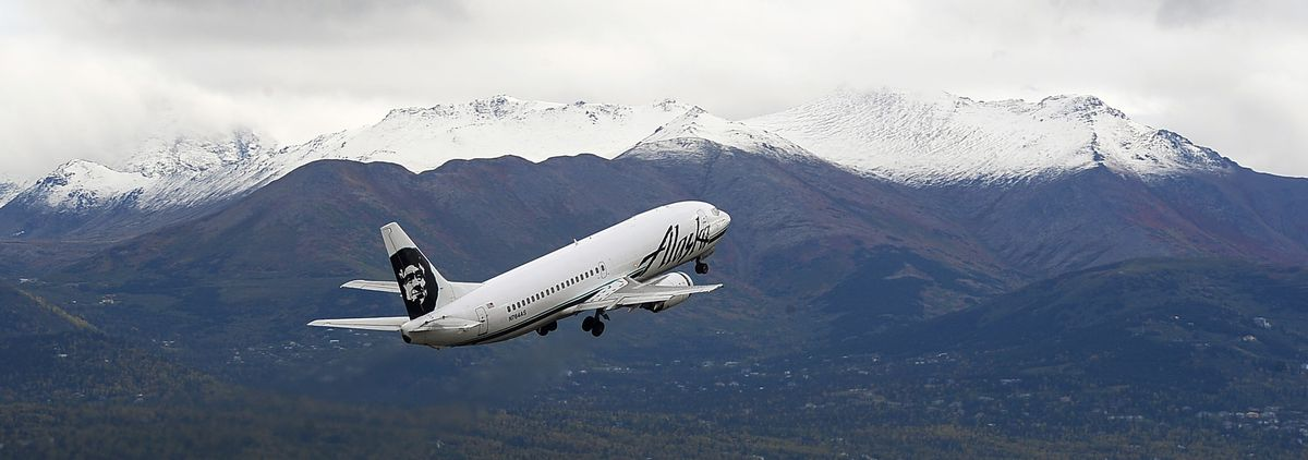 An Alaska Airlines jet takes off September 14, 2015, in a view from West Anchorage.