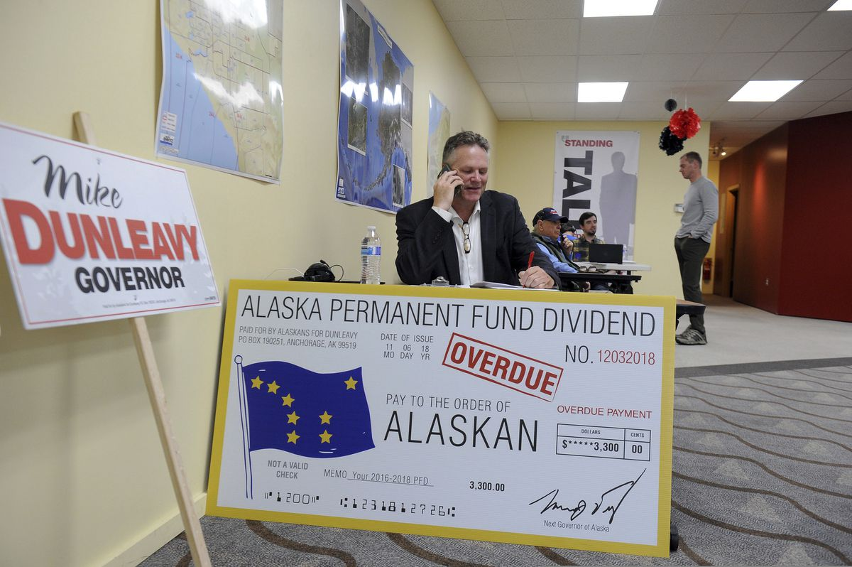 Republican gubernatorial candidate Mike Dunleavy reaches out by phone Tuesday, Aug. 21, 2018, in Anchorage, Alaska. (AP Photo/Michael Dinneen)