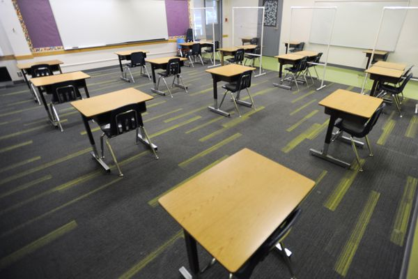 Desks in a Huffman Elementary second grade classroom are placed six feet apart for social distancing on Monday, Nov. 2, 2020. (Bill Roth / ADN)