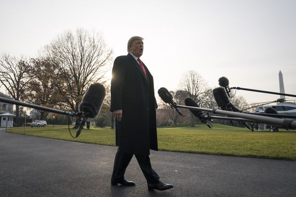 President Trump talks to reporters on the South Lawn of the White House before boarding Marine One ahead of a trip to Utah on Monday. MUST CREDIT: Washington Post photo by Jabin Botsford