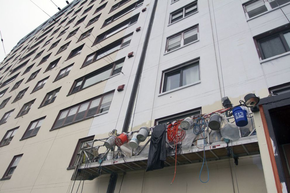 The Begich Towers remain partially painted on Tuesday, August 9, 2016. The painting is one renovation that was capable because of the grant funding. (Sarah Bell / Alaska Dispatch News)