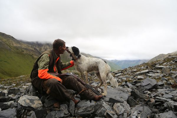Steve Meyer and Winchester doing what they love best - hunting together in the mountains. (Photo by Christine Cunningham)