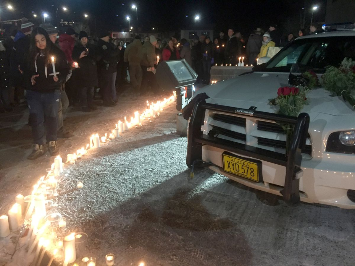 About 300 to 400 people attended a candlelight vigil for Police Sgt. Allen Brandt Friday night outside the Fairbanks police station. (Dermot Cole / Alaska Dispatch News)