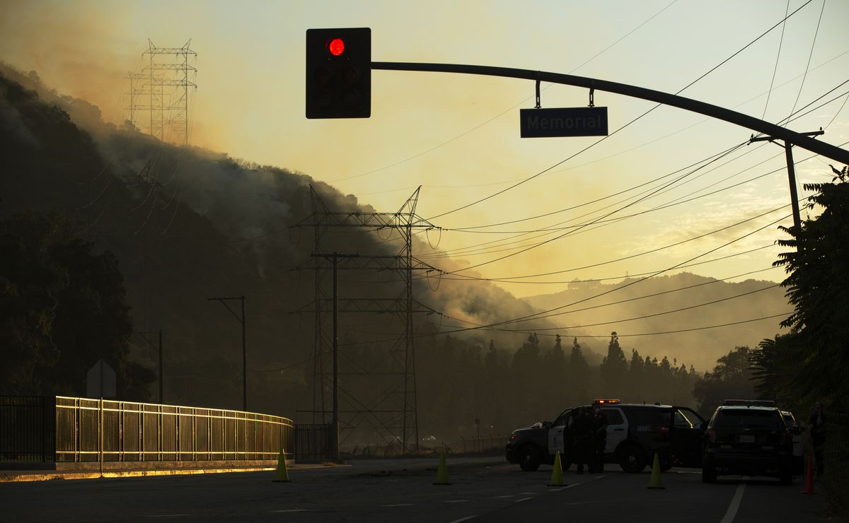 Los Angeles Fire Department air and ground units respond to a fire in the Hollywood Hills area of Los Angeles, Saturday, Nov. 9, 2019. The small brush fire broke out in the Hollywood Hills area of Los Angeles, sending plumes of smoke that could be seen for several miles. (AP Photo/Damian Dovarganes)