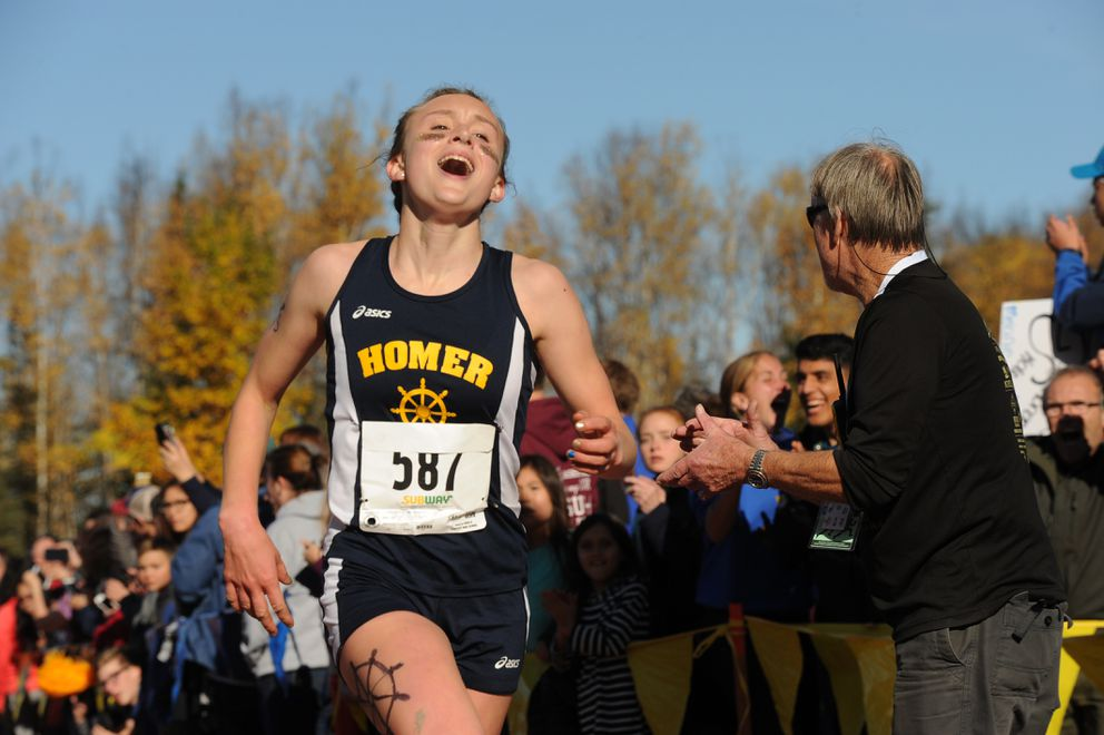 Autumn Daigle of Homer crosses the finish line with a time of 19:30 to win the girls Division II cross country title. (Bob Hallinen / Alaska Dispatch News)
